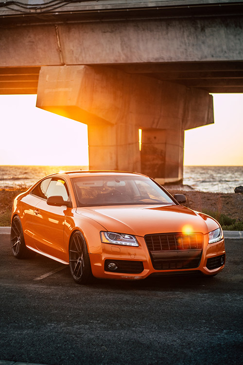 Bronze Orange Audi in sunset